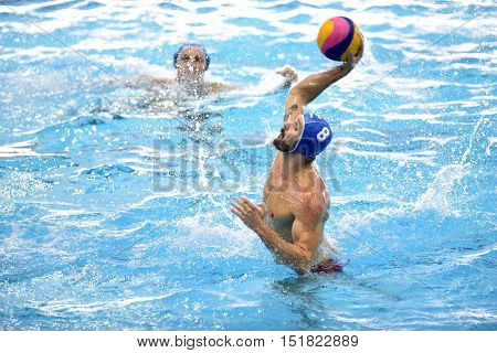 KAPOSVAR, HUNGARY - OCTOBER 5: Marton Szivos (blue 8) in action at a Hungarian national championship water-polo game between Kaposvar (white) and Honved (blue) on October 5, 2016 in Kaposvar, Hungary