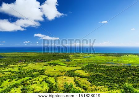 Atlantic Ocean And Field Of Green Grass
