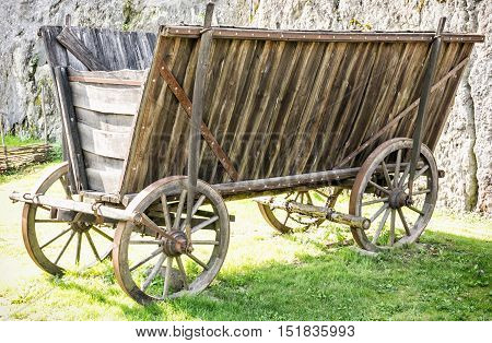 Close up of old wooden cart. Retro wagon. Industrial object.