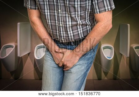 Man With Hands Holding His Crotch, He Wants To Pee