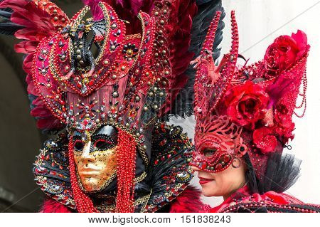 VENICE, ITALY - FEBRUARY 15, 2015: Two models disguised with similar carnival costumes at the Carnival of Venice