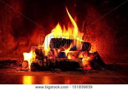 Close up shot of burning firewood in the fireplace. poster