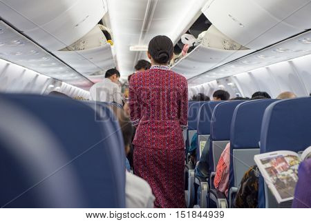Behind the flight attendants on the plane