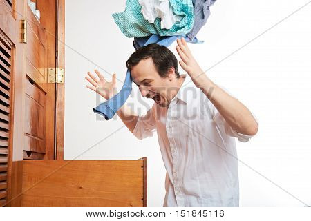 Angry Man Throwing Clothes