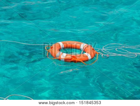 A life buoy in the sea and green sea background