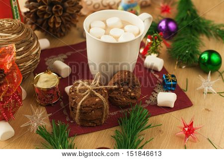 Christmas cocoa with marshmallow and homemade cookies with chocolate and nuts,. New year hot drink. Merry Christmas evening beverage.