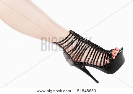 Female leg in sexy black shoe for striptease isolated on white background.