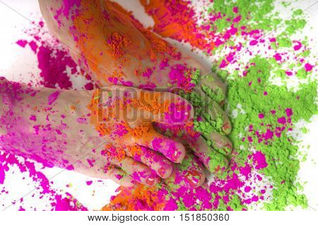Happy Holi Festival! Holi Celebration Party - female feet colored Dry Bright Multicolor Paint Powder. Indian traditional spring color Festival