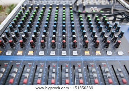 Sound board closeup for outside live performance. Selective focus
