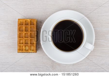 Black Coffee In Cup And Viennese Waffle On Wooden Table