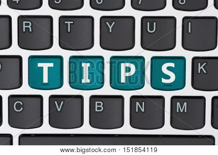 Searching for tips online A close-up of a keyboard with teal highlighted text Tips