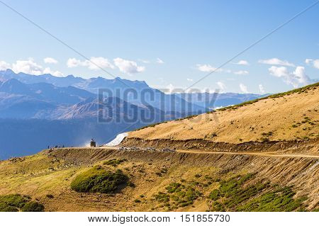 Autumn mountain landscape views of hills and peaks of Caucasus mountains. Krasnaya Polyana - Alpine ski resort constructed from 2003 to 2011 for Sochi games. Rosa Khutor Sochi Russia