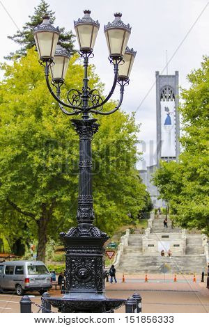 Street lantern on Trafalgar Street, view of Christ Church Cathedral in the far end .Nelson, New Zealand.