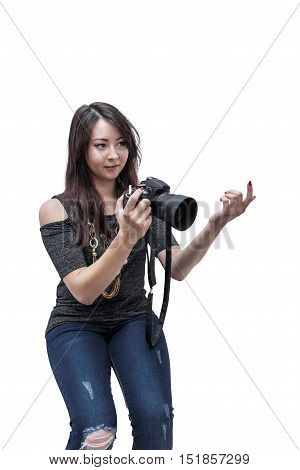young beautiful girl with the camera beckoning finger