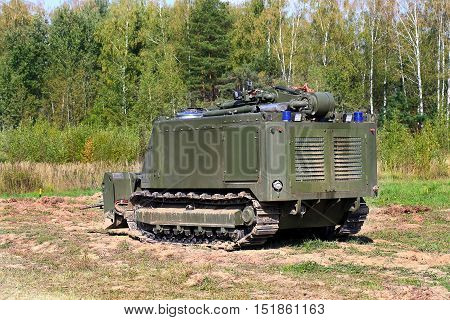 Unmanned ground combat vehicle for remote-controlled demining