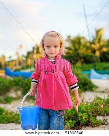 Portrait Of Beautiful Blond-haired Girl Playing On The Beach