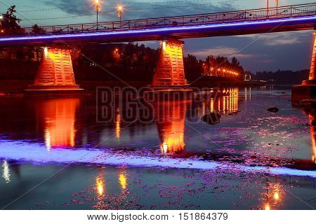 Reflection In The Water Of Illumination The Bridge