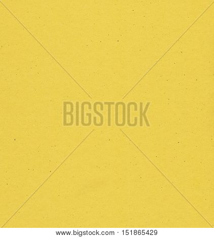 a yellow paperboard useful as a background