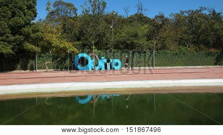 Quito, Pichincha / Ecuador - October 15 2016: People playing in giant letters forming the word QUITO in the La Carolina Park in the north of the city of Quito