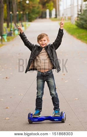 Happy Boy Riding On Hoverboard  On Outdoor.