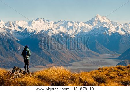 A Woman Hiker Looks Towards The Southern Alps. Hakatere Conservation Park, Southern Alps, New Zealand