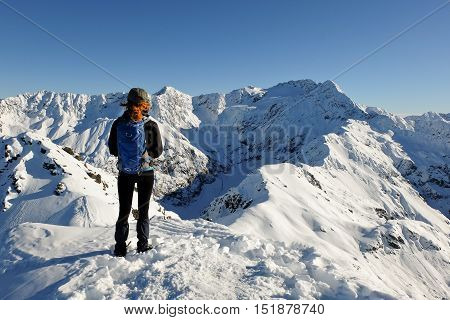 A Woman Hiker Looks Out To the Southern Alps From the Summit of Avalanche Peak.  Arthurs Pass, Canterbury, New Zealand