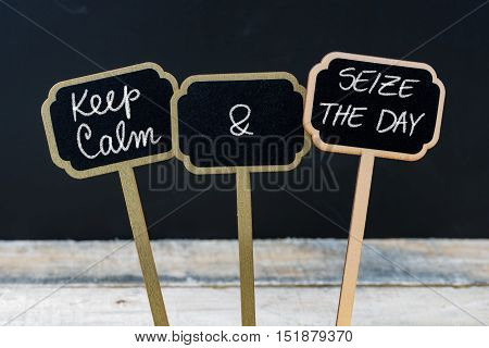 Keep Calm And Seize The Day Message Written With Chalk On Mini Blackboard Labels