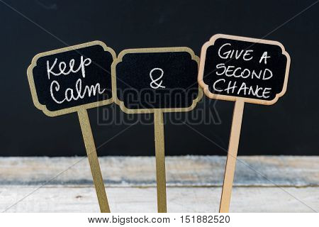 Keep Calm And Give A Second Chance Message Written With Chalk On Mini Blackboard Labels