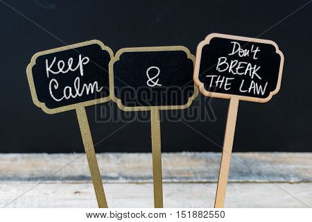 Keep Calm And Do Not Break The Law Message Written With Chalk On Mini Blackboard Labels