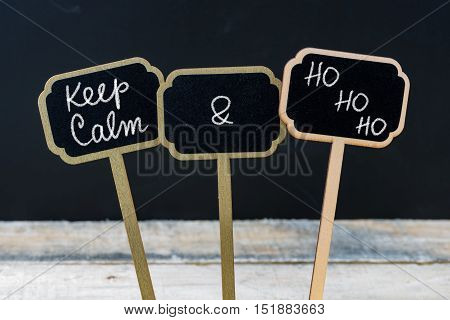 Keep Calm And Ho Ho Ho Message Written With Chalk On Mini Blackboard Labels