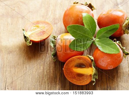 natural fresh organic fruit persimmon on a wooden table