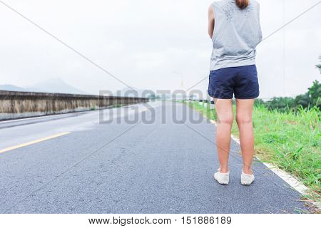 Yung Women Legs And Shoes Standing On Street In A Parks , Morning Walk With Green Nature Background,