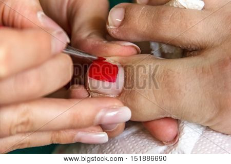 Pedicure, Pedicure Process Professional In The Beauty Salon, Clean Cuticles And Nail On His Feet