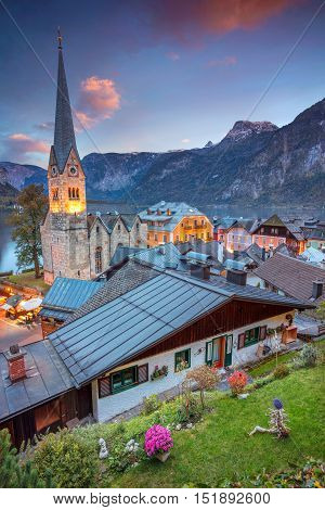 Hallstatt, Austria. Image of famous alpine village Hallstatt during autumn sunset.