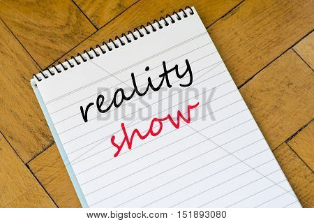 Reality show text concept write on notebook