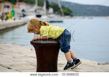 Boy Climbs On Bitt