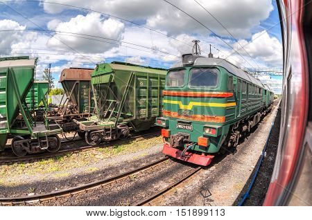 BOLOGOE RUSSIA - JULY 18 2015: Freight train standing at a railway station in summer day. Cargo train logistic