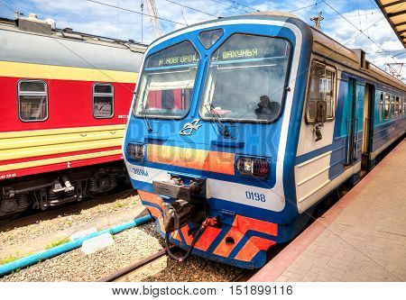 NIZHNY NOVGOROD RUSSIA - JULY 1 2015: Electric train stands on a platform of Moskovsky Rail Terminal in summer day. Trains of the Russian Railways company (RZhD)