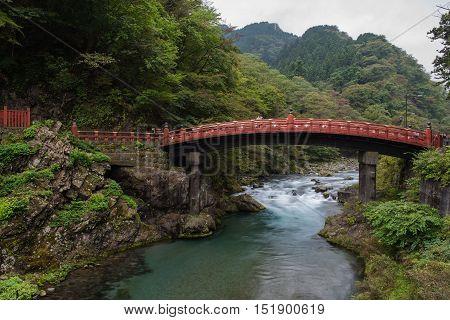 NIKKO, JAPAN - OCTOBER 13 ,2016 : Shinkyo (Sacred Bridge) stands at the entrance to Futarasan Shrine. Red sacred bridge Shinkyo in UNESCO of Nikko.