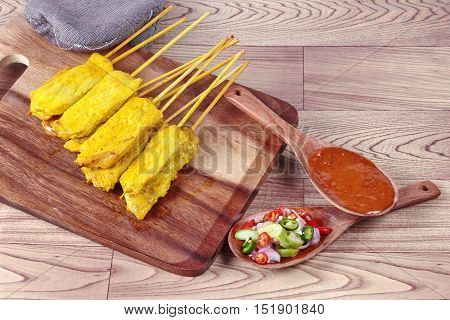 Charcoal boiled pork satay, home made in big size, served with Thai cucumber chili sauce