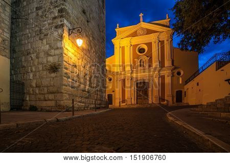 Antibes, France: beautiful medieval city in French Riviera between Cannes and Nice at night. Church of the Immaculate Conception