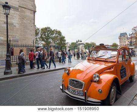 Old Citroen 2Cv Parked At Cathedral Notre-dame De Paris, France.