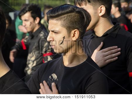 Istanbul Turkey - October 11 2016: Muslims worldwide marks Ashura Istanbul Shiite community. Caferis take part in a mourning procession marking the day of Ashura in Istanbul's Kucukcekmece district Turkey on October 11 2016. Caferi Muslims are observing