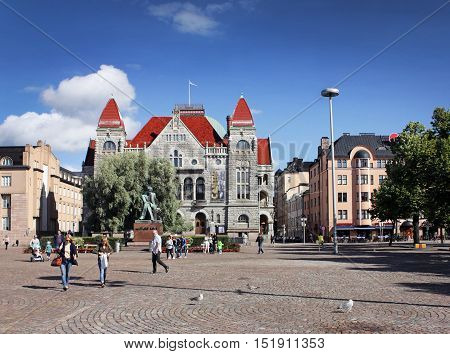 HELSINKI FINLAND - AUGUST 9 2016: Beautiful view of Rautatientori (Railway Square) with Finnish National Theater and Monument to Finnish author Aleksis Kivi born Alexis Stenvall August 9 2016.