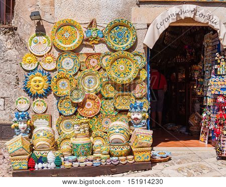 ERICE ITALY - SEPTEMBER 12 2015: Traditional souvenirs of ceramics and Trinacria is symbol of Sicily Italy.