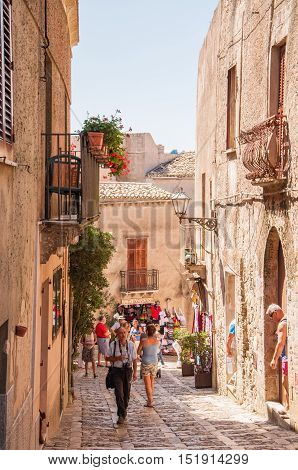 ERICE ITALY - SEPTEMBER 12 2015: The scenic stone paved street of Erice province of Trapani in Sicily Italy.