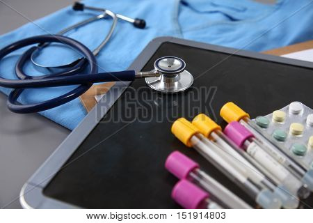 Stethoscope And Medical Instruments For Doctor On Blue Table