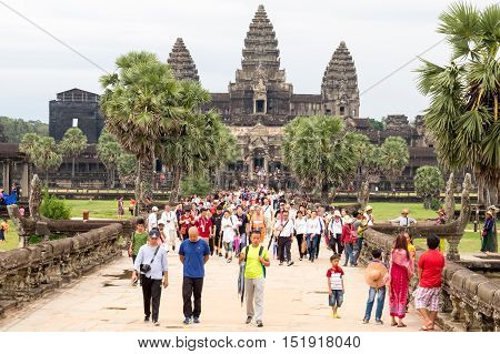 SIEM REAPCAMBODIA-OCT 14 : Tourist went out Angkor Wat in eveningOctober 14 2016 Siem ReapCambodia.