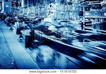 Factory floor car production line motion blur picture.