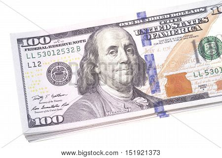 Stacked dollar banknotes over a white background